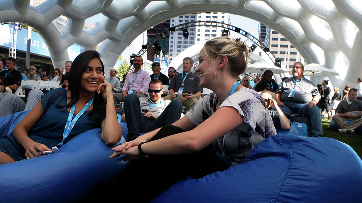 Marisa Andrade (left) of Salesforce and Nicole Olerich of Marketo enjoy a concert during lunch at Dreamforce 2014.