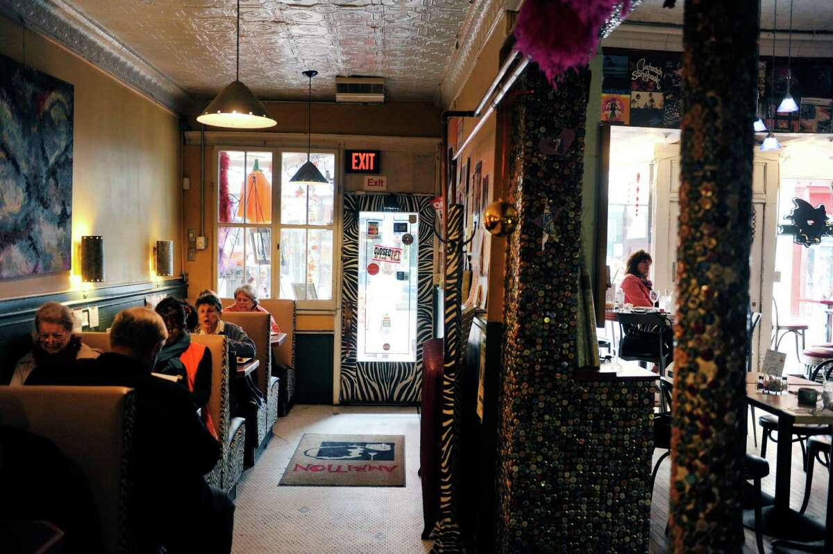 People enjoy lunch inside Ambition Coffee House and Eatery on Monday, Oct. 13, 2014, in Schenectady, N.Y. The shop has seen in increase in business because of the show