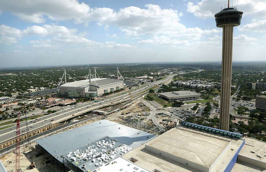 The addition to the convention center can be seen in relation to the Tower of the Americas and the Alamodome.  Construction crews are ahead of schedule and under budget on the $325 million Convention Center expansion. Friday, Oct. 10, 2014. Photo: San Antonio Express-News / © 2014 San Antonio Express-News