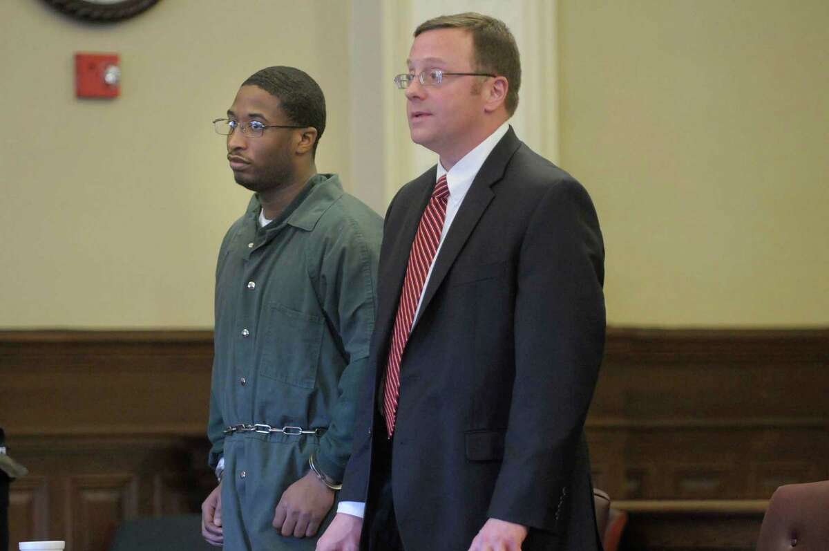 Paul Walker, left, who was found guilty last month of attempting to kill a pizza parlor worker who was trying to foil a robbery attempt, and his lawyer, Michael Mansion, right, stand during Walker's sentencing in Judge Andrew Ceresia's courtroom at the Rensselaer County Courthouse in Troy, NY on Thursday, Jan. 6, 2011. (Paul Buckowski / Times Union)