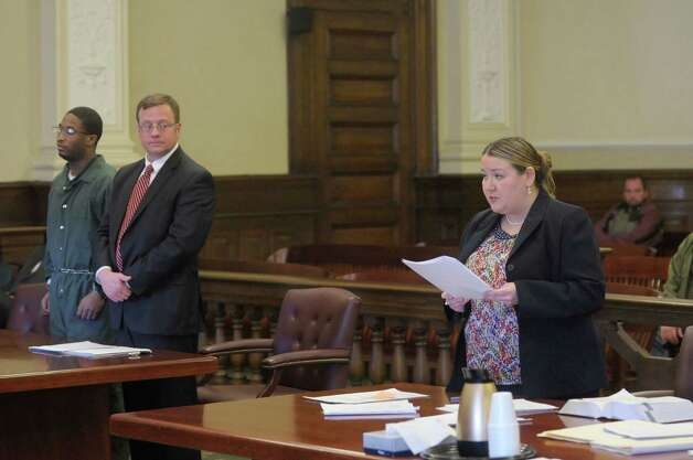 Paul Walker, left, who was found guilty last month of attempting to kill a pizza parlor worker who was trying to foil a robbery attempt, and his lawyer, Michael Mansion, right, listen as Rensselaer County Assistant District Attorney Christa Book, far right, reads a victim impact statement  during Walker's sentencing in Judge Andrew Ceresia's courtroom at the Rensselaer County Courthouse in Troy, NY on Thursday, Jan. 6, 2011.    (Paul Buckowski / Times Union) Photo: Paul Buckowski / 00011657A