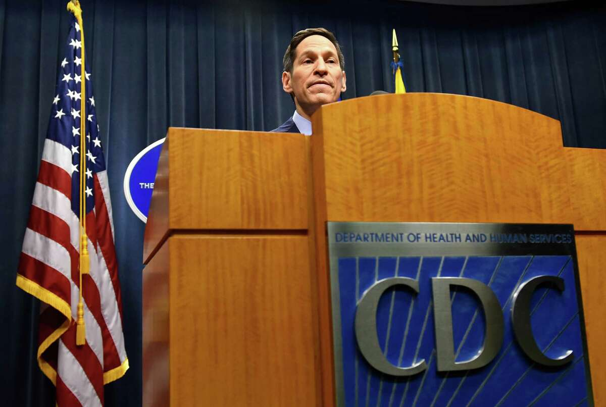 Centers for Disease Control (CDC) Director Tom Frieden provides an update on the latest developments involving the deadly Ebola virus and its infection of a Texas health care professional as he addresses the media during a briefing at CDC headquarters Monday, Oct. 13, 2014, in Atlanta. Frieden said the CDC is working to improve protections for hospital workers after a nurse caring for an Ebola patient in Dallas became the first person to become infected with the disease inside the U.S. (AP Photo/Atlanta Journal Constitution, David Tulis) MARIETTA OUT, GWINNETT OUT ORG XMIT: GAATJ105