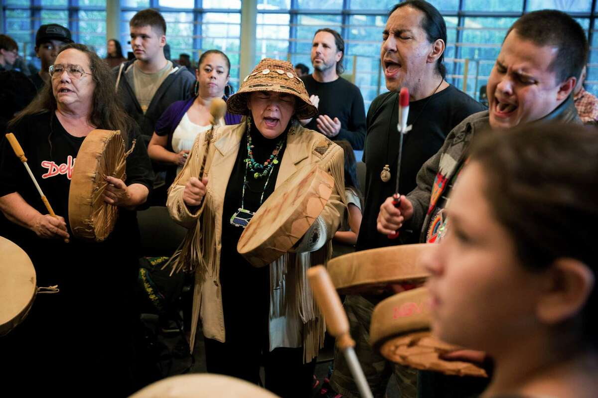 Individuals from various tribes from around the Pacific Northwest join together to form a drum circle following a successful signing ceremony for Resolution No. 31538, honoring indigenous peoples by declaring the second Monday in October ?'Indigenous Peoples?• Day,
