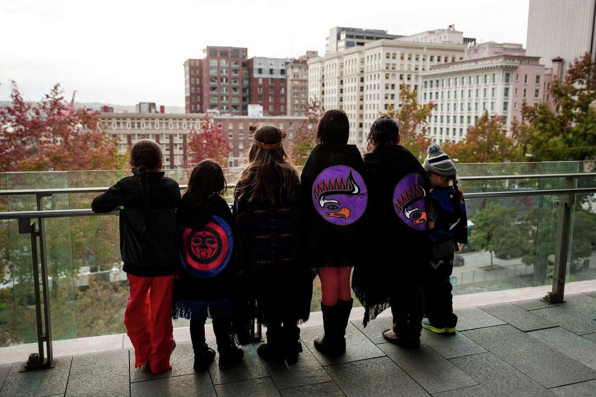 Children from the Tulalip Tribes show off their garments for a picture while taking in a view of downtown Seattle following a successful signing ceremony for Resolution No. 31538, honoring indigenous peoples by declaring the second Monday in October ?'Indigenous Peoples?• Day,