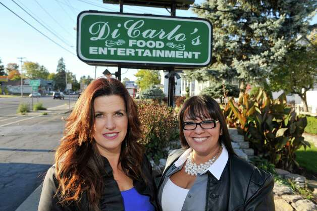 New co-owners of DiCarlo's Gentlemen's Club, Tess Collins, left, and Shy Abbasi pose outside the club on Sunday, Oct. 13, 2014, in Colonie, N.Y.   (Paul Buckowski / Times Union) Photo: Paul Buckowski / 10029013A