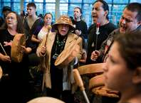 """Individuals from various tribes from around the Pacific Northwest join together to form a drum circle following a successful signing ceremony for Resolution No. 31538, honoring indigenous peoples by declaring the second Monday in October ÒIndigenous PeoplesÕ Day,"""" photographed Monday, October 13, 2014, at Seattle City Hall in Seattle, Washington. (Jordan Stead, seattlepi.com)"""
