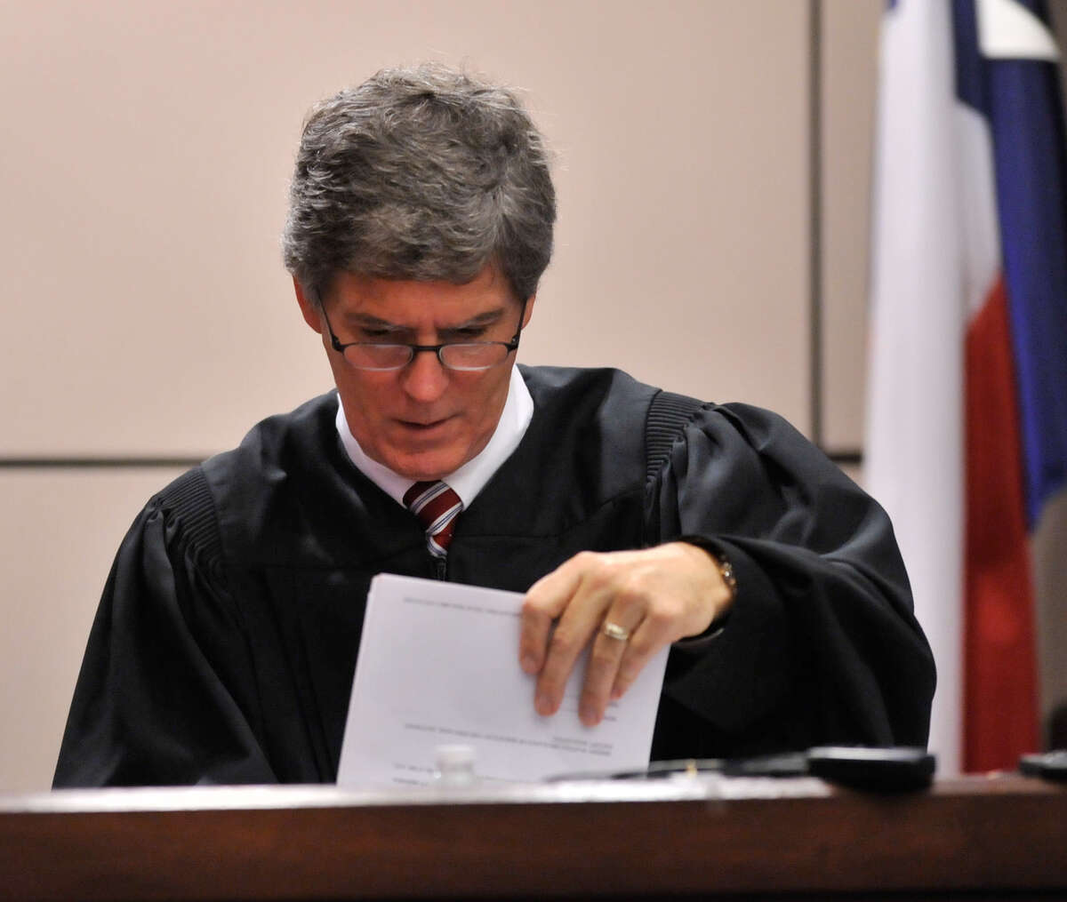 Visiting Judge Bert Richardson has set Oct. 31 as Gov. Perry's court appearance. The judge had prev-iously excus-ed Perry from court on Monday. The governor is traveling abroad this week.