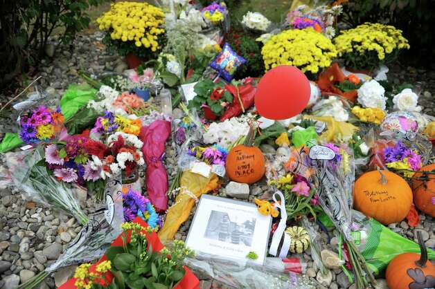 Flowers and other items have been left at the entrance to Guilderland Elementary School, seen here on Monday, Oct. 13, 2014, in Guilderland, N.Y.  The two boys, Anthony, 10, and  Eddy, 7, were found dead along with their parents Jin Chen, and Hai Yan Li last week in their home at 1846 Western Ave. in Guilderland, N.Y.  The two boys went to school at Guilderland Elementary School.   (Paul Buckowski / Times Union) Photo: Paul Buckowski