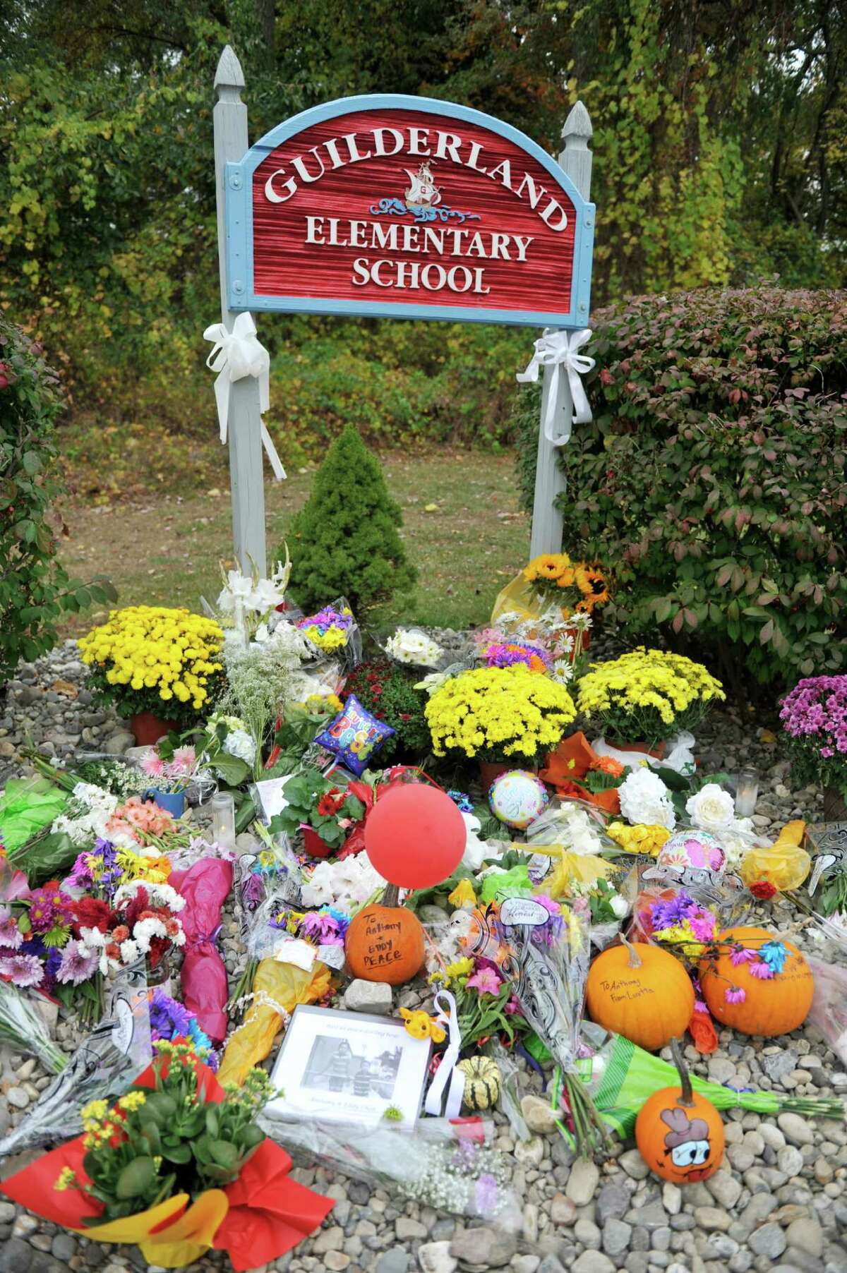 Flowers and other items have been left at the entrance to Guilderland Elementary School, seen here on Monday, Oct. 13, 2014, in Guilderland, N.Y. The two boys, Anthony, 10, and Eddy, 7, were found dead along with their parents Jin Chen, and Hai Yan Li last week in their home at 1846 Western Ave. in Guilderland, N.Y. The two boys went to school at Guilderland Elementary School. (Paul Buckowski / Times Union)