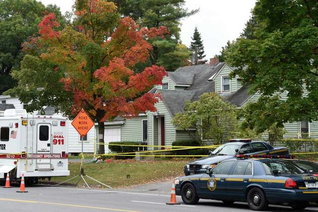 There is still a police presence at the homicide scene at 1846 Western Avenue Monday morning October 13, 2014 in Guildeland, N.Y.   (Skip Dickstein/Times Union) Photo: SKIP DICKSTEIN