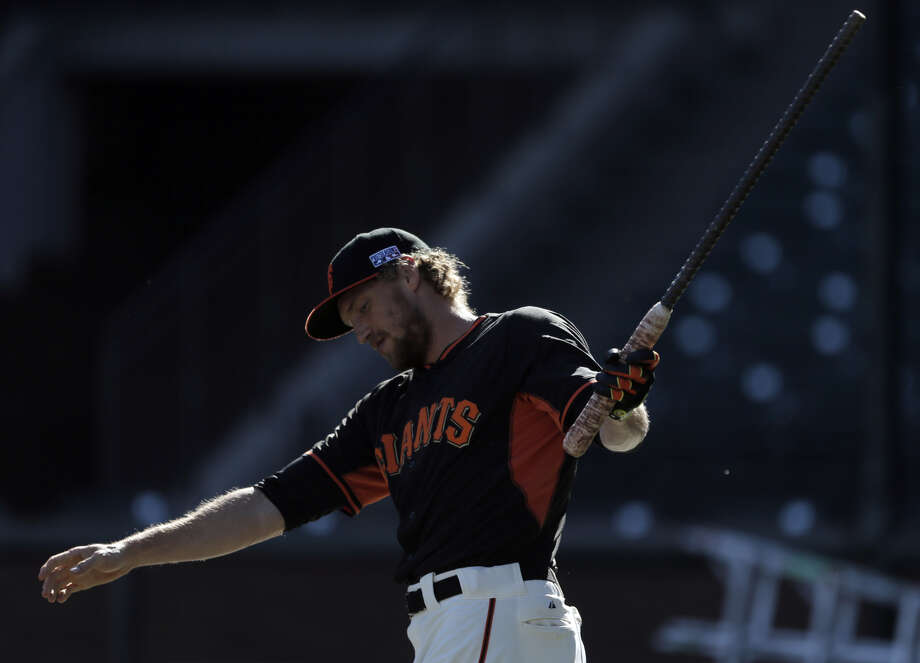Hunter Pence gets loose during the Giants' voluntary off-day workout at AT&T Park. Unlike the Cardinals, the team didn't fly back until Monday, and the workout was lightly attended. Photo: Carlos Avila Gonzalez / The Chronicle / ONLINE_YES