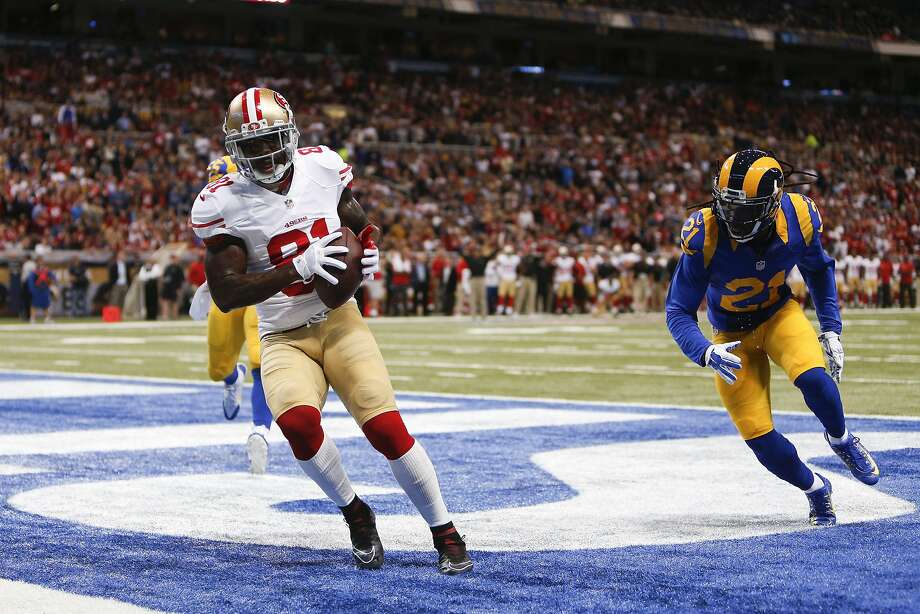 San Francisco 49ers wide receiver Anquan Boldin (81) scores a touchdown on an 11-yard pass play as he is defended by St. Louis Rams cornerback Janoris Jenkins (21) in the third quarter of an NFL football game Monday, Oct. 13, 2014, in St Louis. (AP Photo/Scott Kane) Photo: Scott Kane, Associated Press