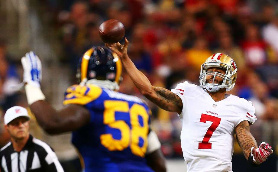 ST LOUIS, MO - OCTOBER 13:   Colin Kaepernick #7 of the San Francisco 49ers passes against the St. Louis Rams in the second quarter at Edward Jones Dome on October 13, 2014 in St Louis, Missouri.  (Photo by Dilip Vishwanat/Getty Images) Photo: Dilip Vishwanat, Getty Images