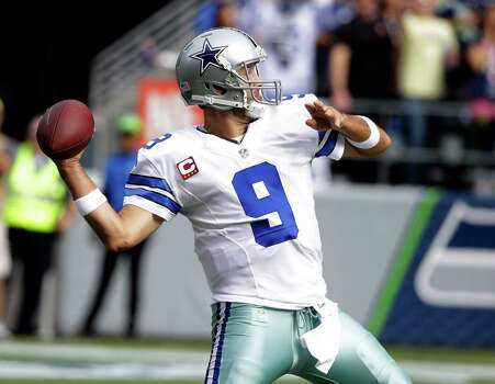 Dallas Cowboys quarterback Tony Romo passes against the Seattle Seahawks in the first half of an NFL football game, Sunday, Oct. 12, 2014, in Seattle. (AP Photo/Elaine Thompson) Photo: Elaine Thompson, Associated Press / AP
