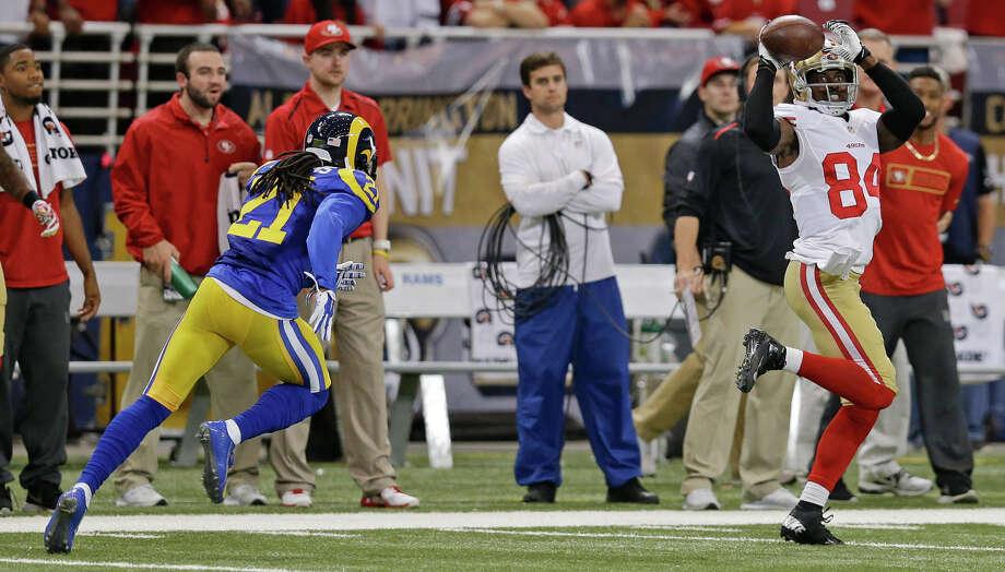 49ers wideout Brandon Lloyd catches an 80-yard TD pass ahead of the Rams' Janoris Jenkins. Photo: Scott Kane / Associated Press / FR171020 AP