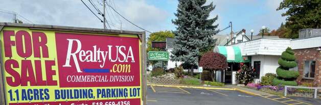 For sale sign at  DiCarlo's on Central Avenue Thursday Oct. 2, 2014, in Colonie, NY.  (John Carl D'Annibale / Times Union) Photo: John Carl D'Annibale