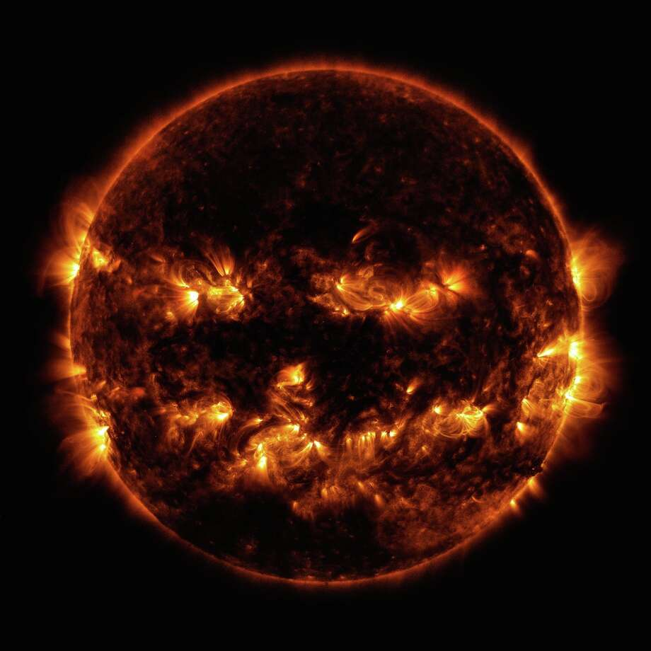 This NASA image of the sun captured Oct. 8, 2014, looks like a jack-o-lantern face. (NASA/GSPC/SDO)