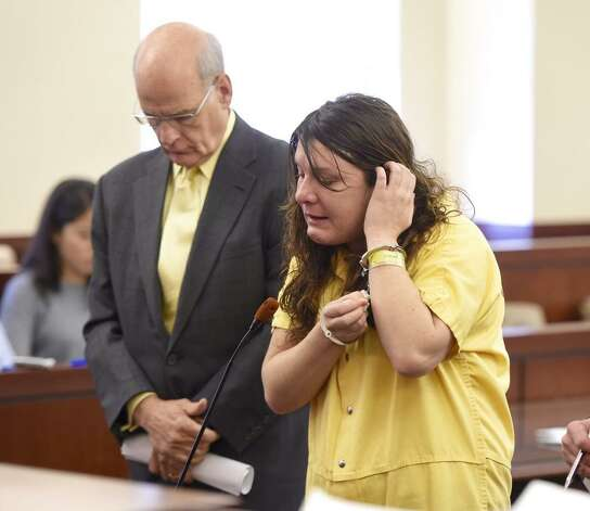 Sare Moore, right, speaks to Albany County Judge Stephen Herrick before he sentenced her to 25 years to life in state prison for killing 79-year-old Richard Englander in February. A home health aide. Moore was hired to care for Englander. At left is her attorney, Stephen Coffey. (Skip Dickstein / Times Union)