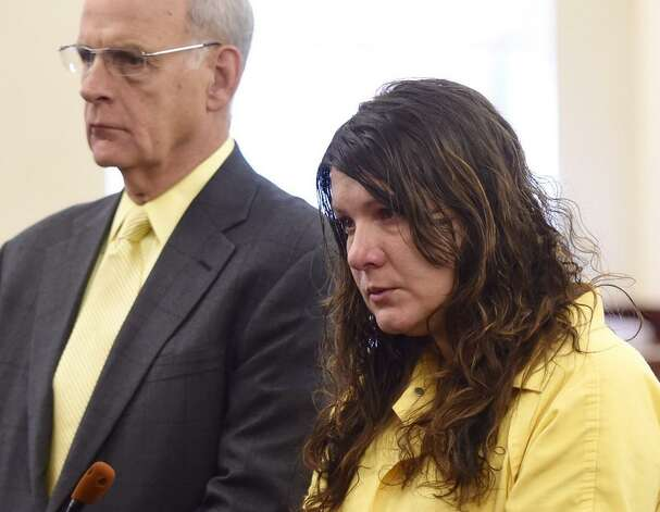 Sara Moore, right, speaks to Albany County Judge Stephen Herrick before he sentenced her to 25 years to life in state prison for killing 79-year-old Richard Englander in February. A home health aide. Moore was hired to care for Englander. At left is her attorney, Stephen Coffey. (Skip Dickstein / Times Union)