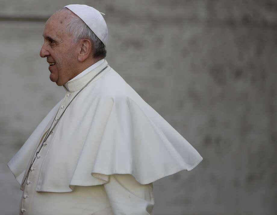 Pope Francis arrives for an afternoon session of a two-week synod on family issues at the Vatican, Thursday, Oct. 9, 2014. (AP Photo/Gregorio Borgia) Photo: Associated Press