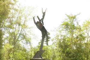 The On the Shoulders of Giants statue at the corner of Grogan's Mill and Research Forest. Photograph by David Hopper