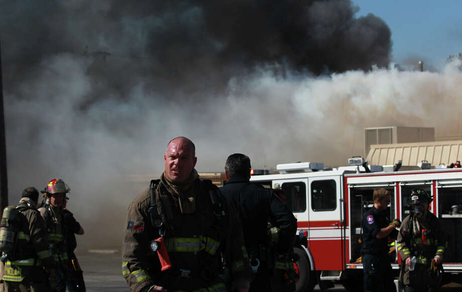 San Antonio firefighters work to extinguish a fire Oct. 13 at the New Jerusalem Baptist Church at 422 Pennystone on the city's Southeast Side. The cause of the blaze is under investigation. The fire broke out shortly after 10 a.m. Photo: JOHN DAVENPORT / San Antonio Express-News / ©San Antonio Express-News/John Davenport