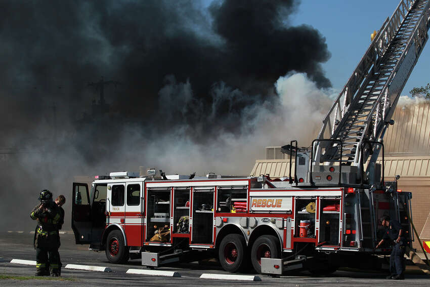 San Antonio firefighters work to extinguish a fire Monday October 13, 2014 at the New Jerusalem Baptist Church at 422 Pennystone on the city's Southeast Side. The cause of the blaze is under investigation. The fire broke out shortly after 10:00 a.m. .