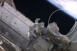 Watch this space. A video published on the NASA YouTube channel of a spacewalk outside the International Space Station appears to show a blurry object appear behind an astronaut where nothing before was present.