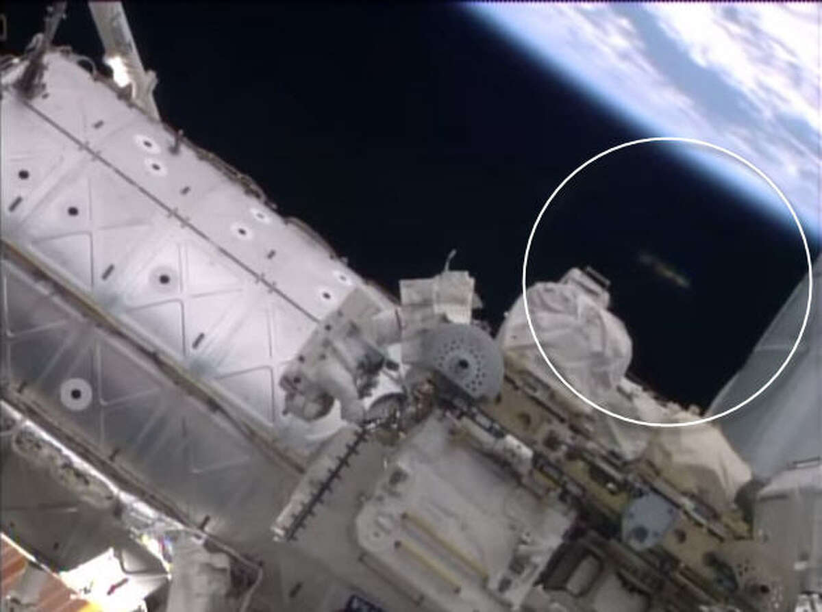 Was a UFO watching NASA astronauts? Something is there now ... but what? A video published on the NASA YouTube channel of a spacewalk outside the International Space Station appears to show a blurry object appear behind an astronaut where nothing before was present. Nothing now ....Check out these other alien mysteries (some of them pretty laughable) caught by alien conspiracy theorists in recent NASA photos ...