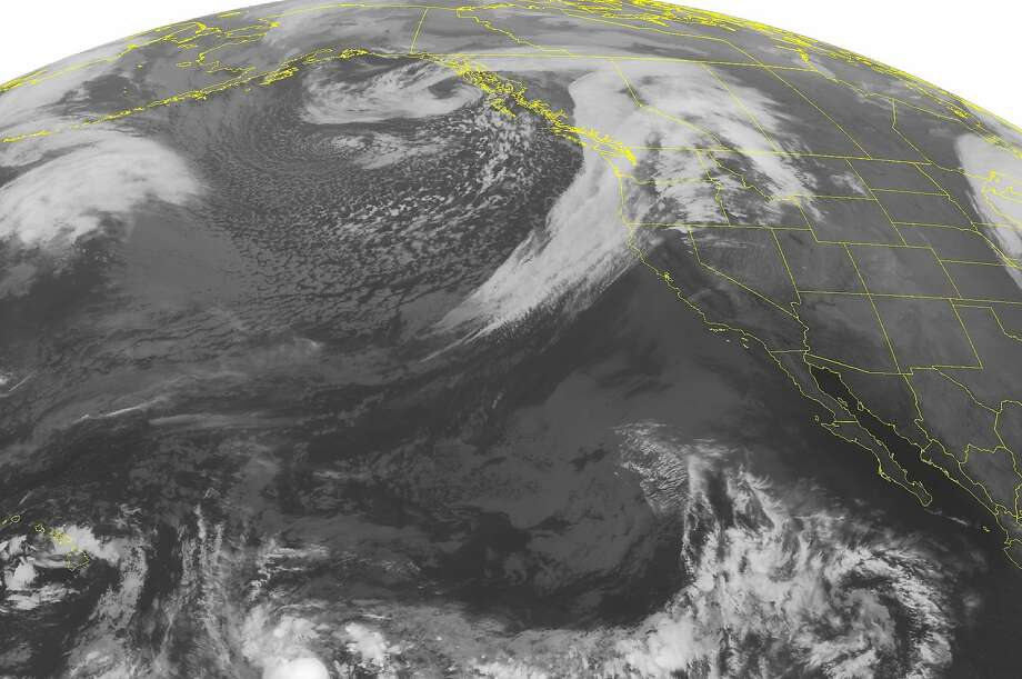 This NOAA satellite image taken Tuesday, Oct. 14, 2014 shows a large occluded low pressure system over western Canada producing rain for much of the Pacific Northwest. The rain will be heading down to the San Francisco Bay Area this evening. Photo: Noaa, Associated Press