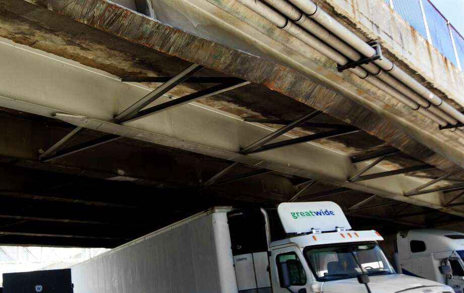 A beam on the Houston Ave. bridge over Interstate 10 is bent after an eighteen wheel truck with oil field reel tubing as cargo hit it on Oct. 14, 2014. Photo: J. Patric Schneider, For The Chronicle / © 2014 Houston Chronicle