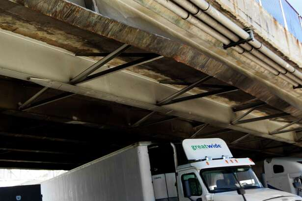 A beam on the Houston Ave. bridge over I-10 is bent after an eighteen wheel truck with oil field reel tubing as cargo hit it around 11:45 a.m. on Tuesday, Oct. 14, 2014, in Houston.