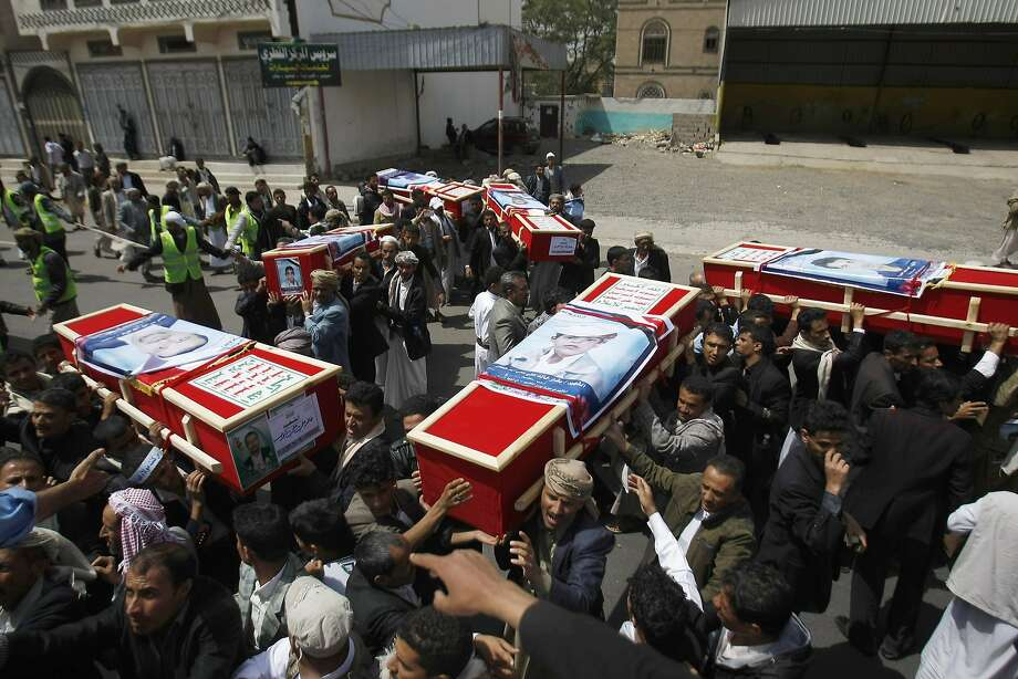 Mourners carry coffins during a mass funeral for victims who were killed last Thursday by a suicide bomber in central Sanaa, Yemen, Tuesday, Oct. 14, 2014.  Two suicide bombings in Yemen killed nearly 70 people last Thursday, with one targeting an anti-government rally by followers of the Houthi Shiite group,  who control Sanaa. Photo: Hani Mohammed, Associated Press