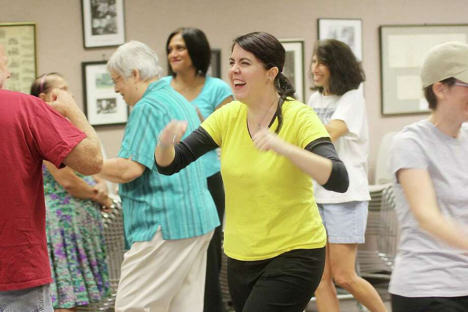 Lainie Diamond leads her laughter yoga class by example. Photo: Pin Lim, Freelance / Copyright Pin Lim.