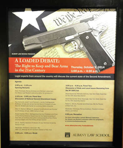 """Sign at the Albany Law Review's fall symposium """"A Loaded Debate: The Right to Keep and Bear Arms in the 21st Century"""" at Albany Law School on Thursday, Oct. 9, 2014 in Albany, N.Y. Legal experts from around the country discussed the current state of the Second Amendment.  (Lori Van Buren / Times Union) Photo: Lori Van Buren, Albany Times Union / 10028975A"""