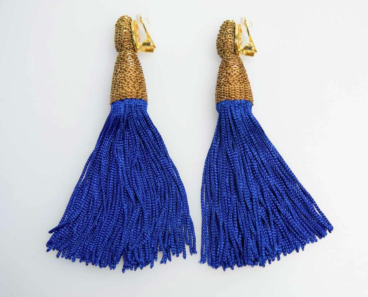 Cobalt blue fringe earrings by Oscar de la Renta, $425, Julian Gold.