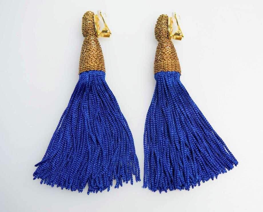 Cobalt blue fringe earrings by Oscar de la Renta, $425, Julian Gold. Photo: William Luther, Staff / San Antonio Express-News / © 2014 San Antonio Express-News