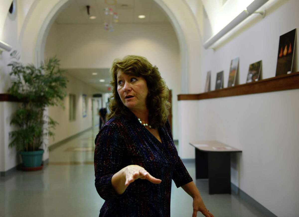 Betsy Paynter, Newtown's Economic Development Coordinator, talks about town projects during an interview at the Municipal Center on the Fairfield Hills campus Tuesday, Oct. 14, 2014.