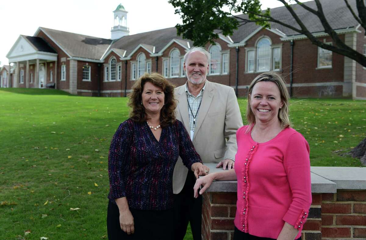 Members of Newtown's economic development team, from left, Betsy Paynter, Economic Development Coordinator, George Benson, Director of Planning, and Christal Preszler, Grant Coordinator stand outside of the town's Municipal Center on the Fairfield Hills campus Tuesday, Oct. 14, 2014.
