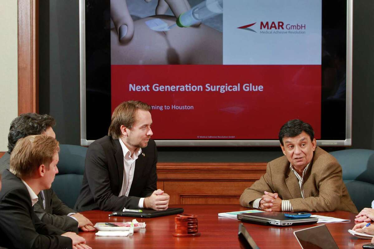 CEO Marius Rosenberg, left, facing camera, of Medical Adhesive Revolution, and Ashok Rao. Medical Adhesive Revolution is the German company that won Rice Alliance's startup award earlier this year. (For the Chronicle/Gary Fountain, October 13, 2014)