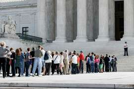 Visitors line up to enter the Supreme Court in Washington, Tuesday, Oct. 14, 2014, as the justices begin the second week of the new term. The landscape has changed very quickly for gay marriage in the U.S. The Supreme Court days earlier had declined to hear appeals from several states seeking to retain their bans on same-sex marriage. The Oct. 6 move effectively legalized gay marriage in about 30 states. In the current term, the court has taken up a case that could result in a ruling declaring a constitutional right for same-sex couples to marry nationwide. Nearly 400 business have told the court they support such a decision as good for business.