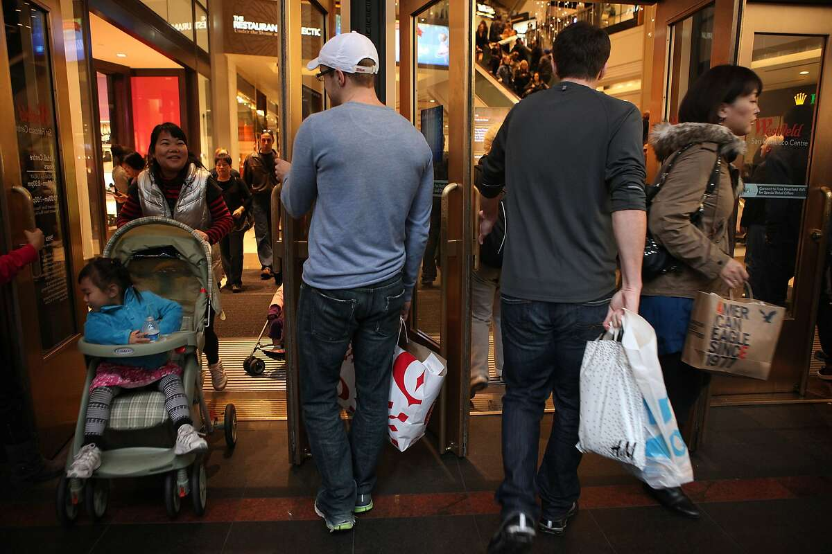 Shoppers exiting and entering Westfield SF Centre shopping mall during late afternoon on Black Friday in San Francisco, Calif., on Friday, November 25, 2011.
