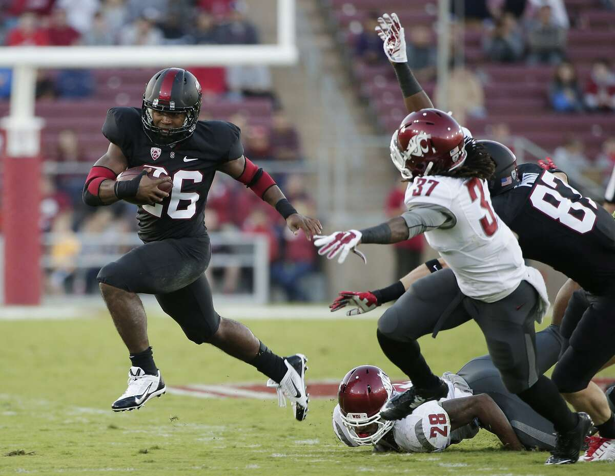 Stanford running back Barry Sanders (26) runs against Washington State during the first half of an NCAA college football game on Friday, Oct. 10, 2014, in Stanford, Calif. (AP Photo/Marcio Jose Sanchez)