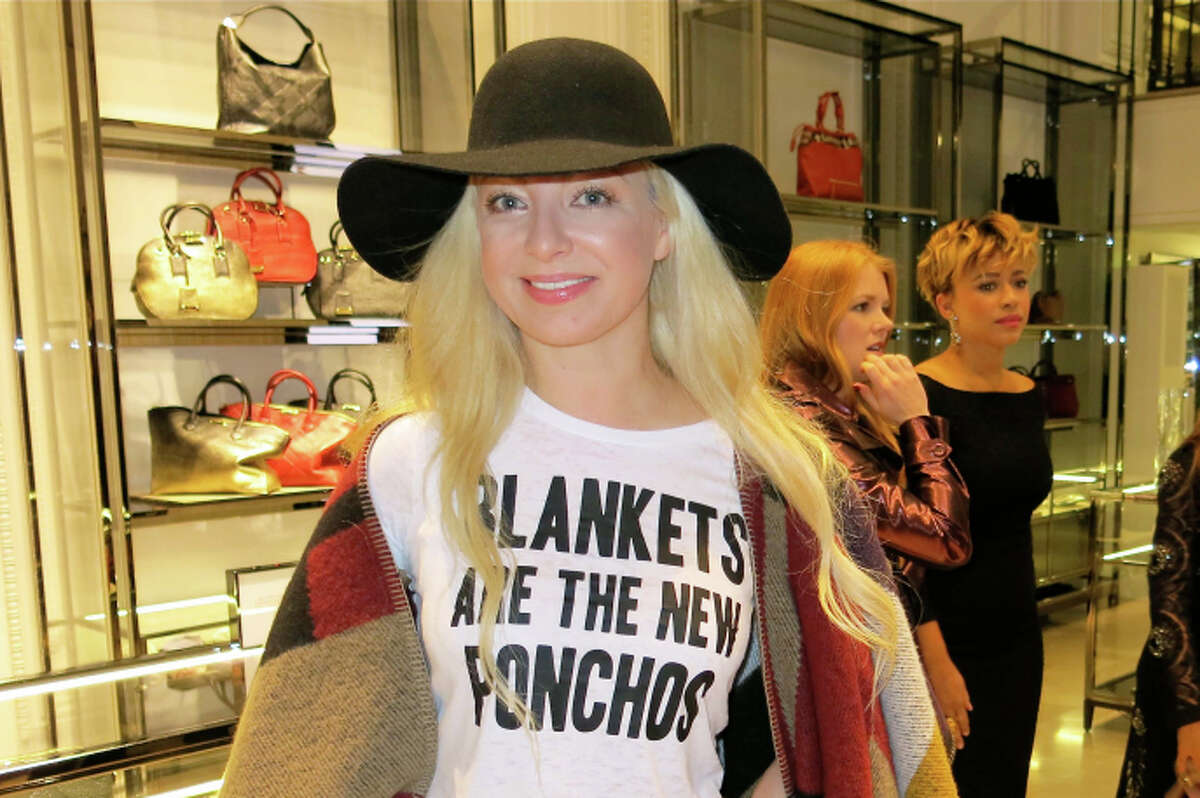 :Sonya Molodetskaya models her Burberry poncho and DIY T-shirt at the boutique's reopening party.