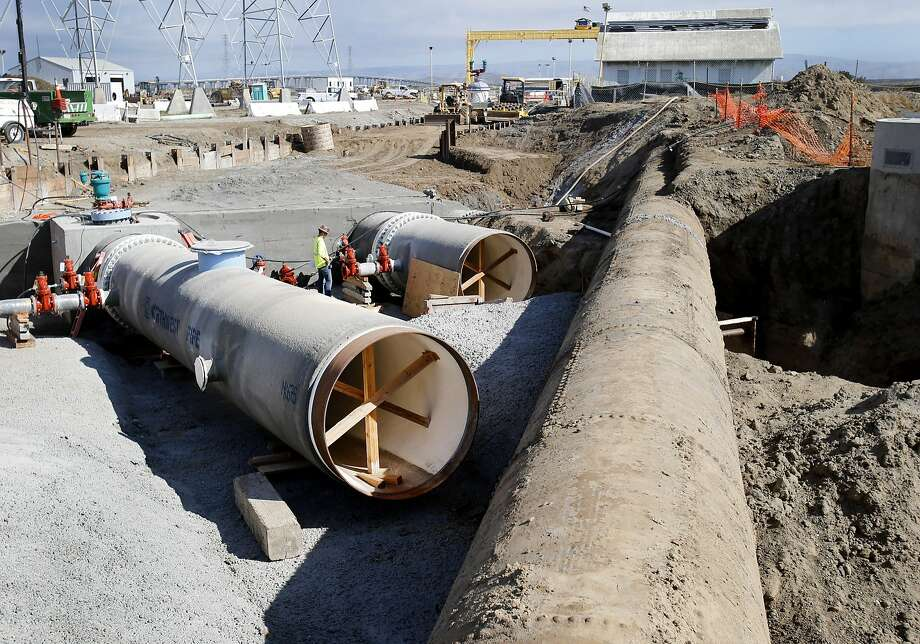 Portions of the new pipes (left) meet up with one of the existing pipes bringing water north up the Peninsula Thursday October 9, 2014 in Menlo Park, Calif. A new five mile tunnel underneath a portion of the San Francisco bay will bring Hetch Hetchy water to the Peninsula more safely. Photo: Brant Ward, The Chronicle
