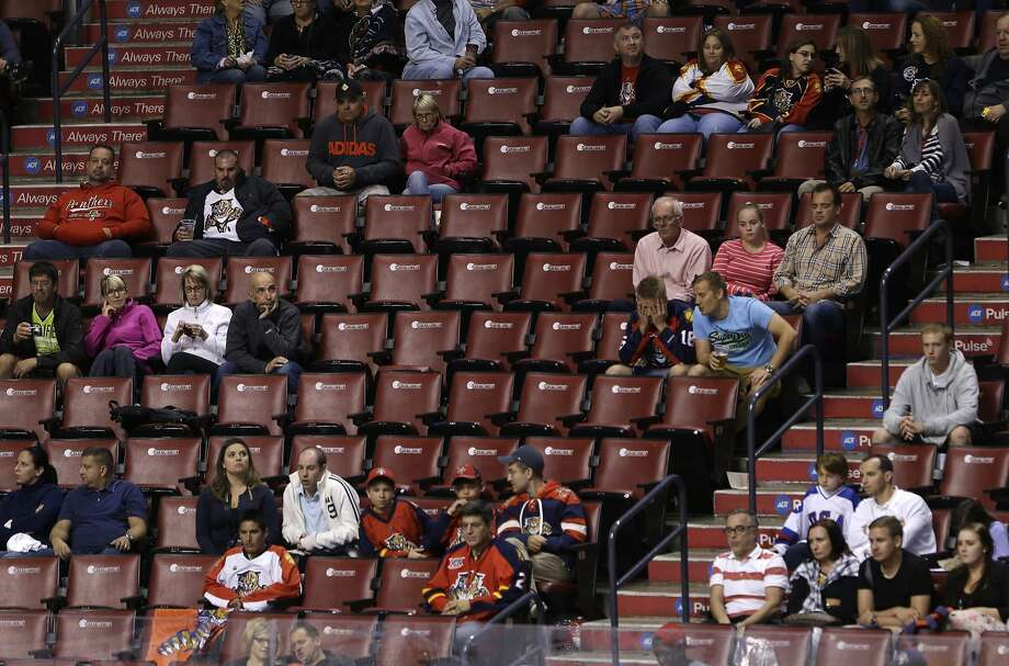 Hockey fans look on during the third period of an NHL hockey game between the Florida Panthers and the Ottawa Senators, Monday, Oct. 13, 2014 in Sunrise, Fla. The Senators defeated the Panthers 1-0 in front of the smallest crowd in Panthers history. (AP Photo/Wilfredo Lee) Photo: Wilfredo Lee, Associated Press