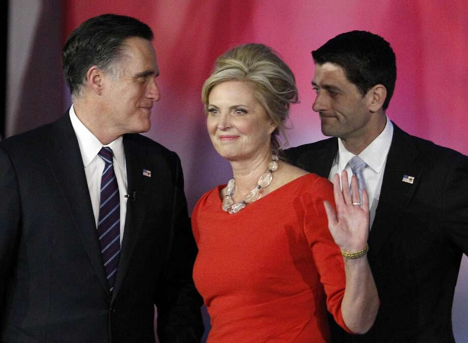 In this Nov. 7, 2012, file photo, Republican presidential candidate and former Massachusetts Gov. Mitt Romney, left, speaks to his running mate, vice presidential candidate, Rep. Paul Ryan, right, R-Wis., as Romney's wife Ann waves to supporters after Romney conceded the race during his election night rally in Boston. Romney and his wife Ann announce an initiative to accelerate treatment and cures for complex neurological diseases, in partnership with Boston's Brigham and Women's Hospital. Photo: Stephan Savoia, Associated Press