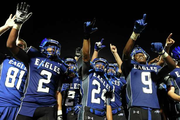 The New Caney Eagles celebrate their 58-33 victory over the Porter Spartans in a high school football game, Friday, September 12, 2014, at Texan Drive Stadium in Porter, TX. (Photo: Eric Christian Smith/For the Chronicle)