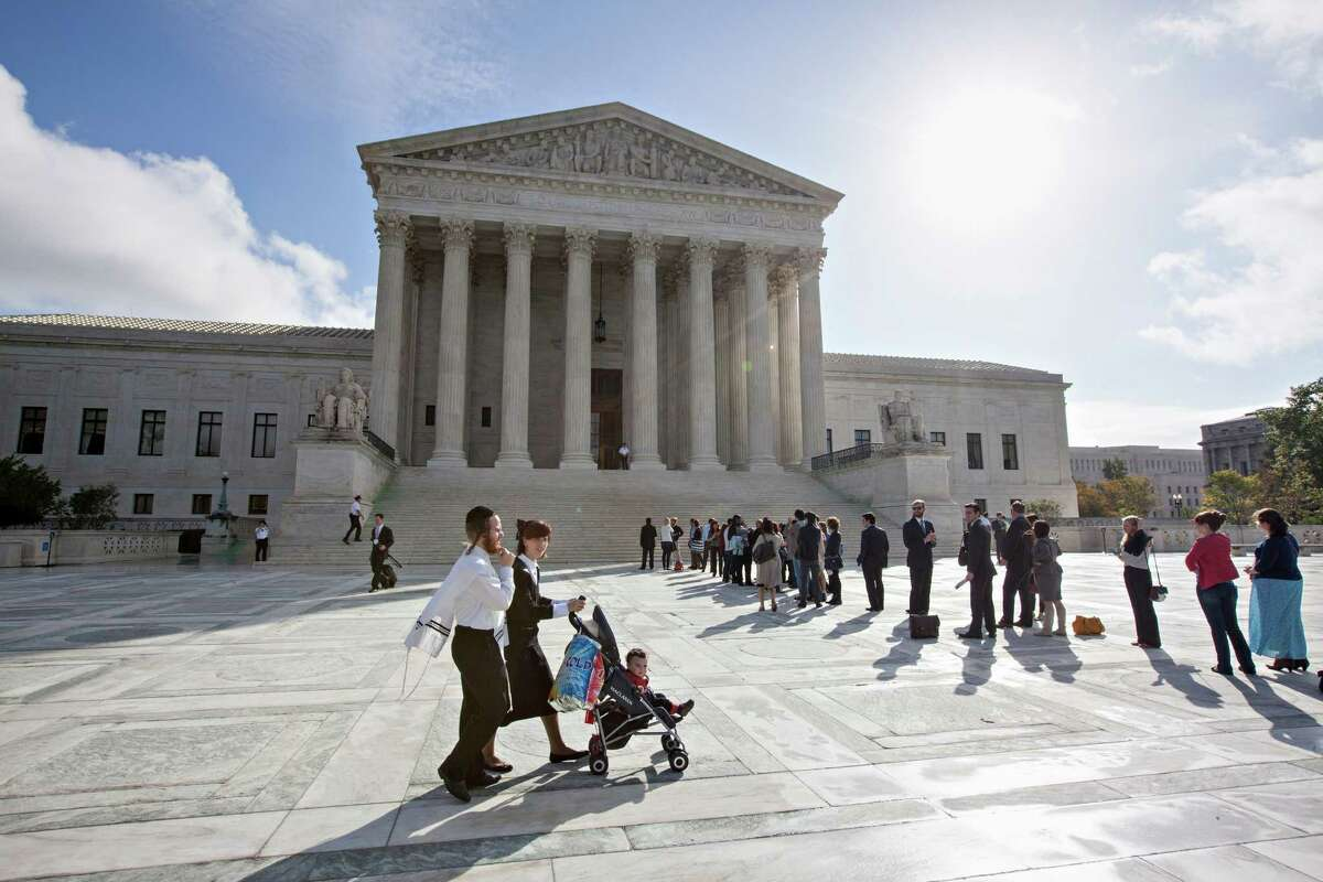 A majority of the justices rejected an emergency request from the Justice Department and civil rights groups to prohibit the state from requiring voters to produce certain forms of photo identification in order to cast ballots.