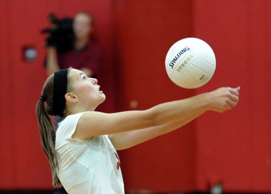 Izzy Chudy of Greenwich returns a shot during the girls high school volleyball between Greenwich High School and Darien High School at Greenwich, Tuesday, Oct. 14, 2014. Darien won the match over Greenwich, 3-0. Photo: Bob Luckey / Greenwich Time